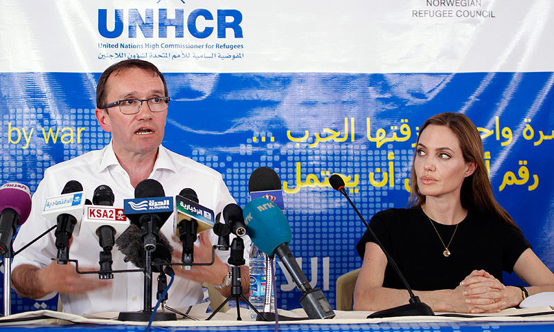 Actress Angelina Jolie (R), the U.N. refugee agency's special envoy, listens to Norway's Foreign Minister Espen Barth Eide speak during a news conference at the Al Zaatri refugee camp, which is hosting Syrians displaced by the conflict, on World Refugee Day, in the Jordanian city of Mafraq, near the border with Syria June 20, 2013.— Reuters Photo