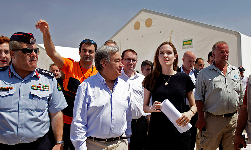 UN refugee chief, Antonio Guterres, second left, along with United Nations High Commissioner for Refugees (UNHCR) special envoy, actress Angelina Jolie, second right, visit Zaatari refugee camp, near the Syrian border, in Mafraq, Jordan, Thursday, June 20, 2013. — AP Photo