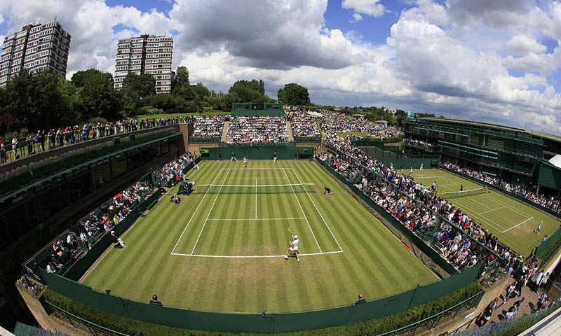 An elevated view shows the match between Alexandra Dulgheru of Romania and Svetlana Kuznetsova of Russia on Court 18 at the Wimbledon tennis championships in London June 23, 2011. — Reuters Photo