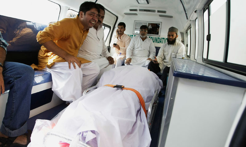 Family members of  slain lawmaker Sajid Qureshi sit in an ambulance in Karachi, Pakistan, on Friday, June 21, 2013.—AP Photo