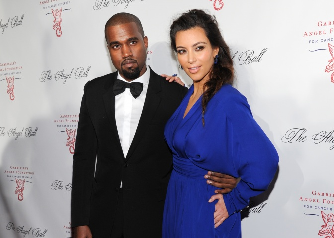 Singer Kanye West and girlfriend Kim Kardashian attend a benefit in New York. - AP Photo