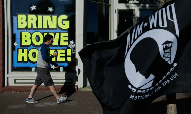 "A man walks past a ""Bring Bowe Back"" sign honoring captive U.S. Army Sgt. Bowe Bergdahl in Hailey, Idaho, Saturday, June 22, 2013. – AP Photo"