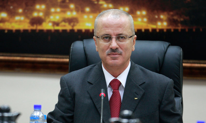 Palestinian Prime Minister Rami Hamdallah attends his first meeting of the new government cabinet in the West Bank city of Ramallah. The new Palestinian prime minister submitted his resignation to Palestinian President Mahmoud Abbas on Thursday, June 20, 2013, after two weeks on the job, because of a conflict over authority.—Photo by AP