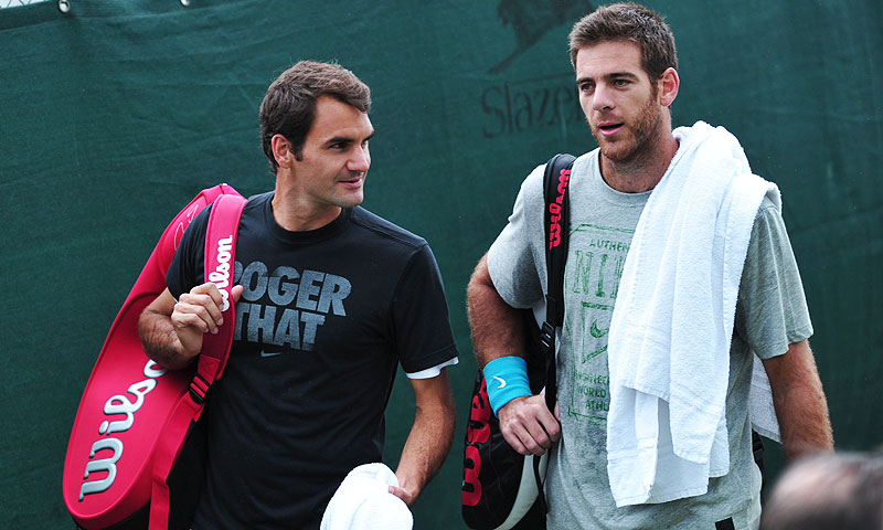 Switzerland's Roger Federer (L) and Argentina's Juan Martin del Potro (R) leave after a training session. -Photo by AFP