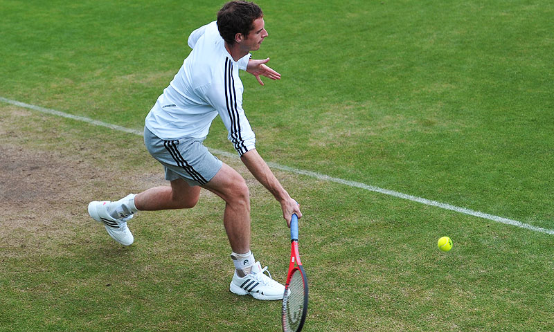 Britain's Andy Murray plays a shot on the practice court. -Photo by AFP