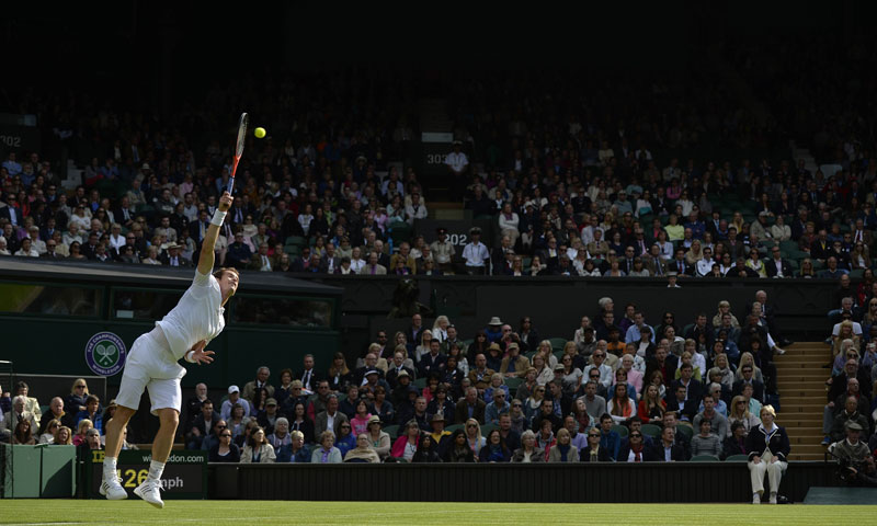 Britain's Andy Murray serves against Germany's Benjamin Becker.
