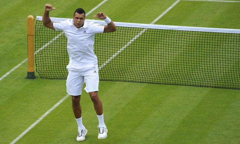 France's Jo-Wilfried Tsonga celebrates beating Belgium's David Goffin.
