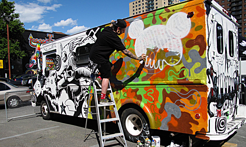 A mural in progress is seen on the side of a van during the Mural Festival on June 6, 2013 in Montreal, Canada. The festival is the first of its kind in Canada, an open-air museum featuring work by some 35 artists from around the world. — AFP Photo