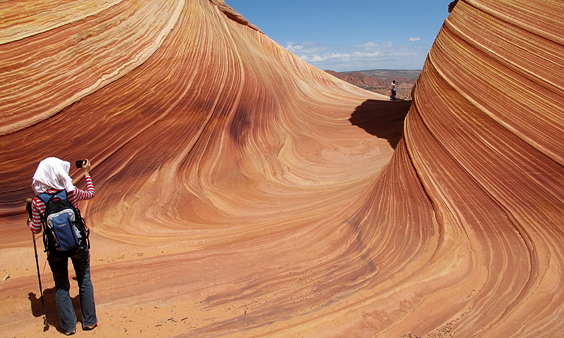This May 28, 2013 photo shows a hiker taking a photo on a rock formation known as The Wave  in the Vermilion Cliffs National Monument in Arizona.