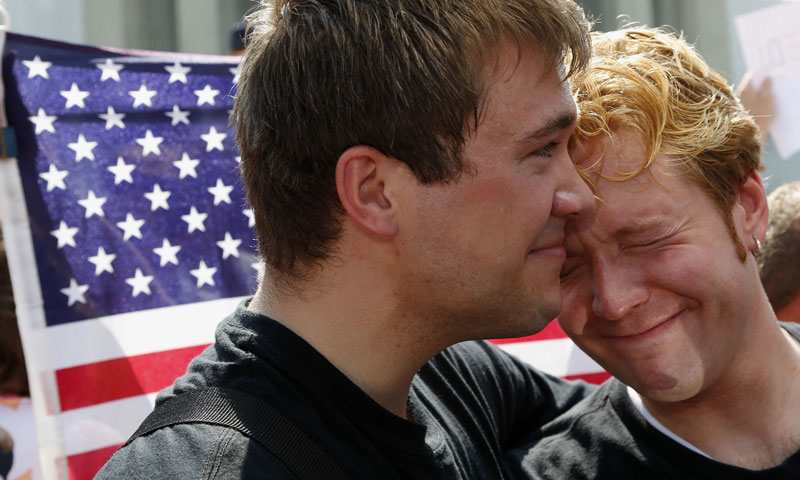 Michael Knaapen, left, and his husband John Becker, right, embrace outside the Supreme Court in Washington, Wednesday, June 26, 2013, after the court cleared the way for same-sex marriage in California.—AP Photo