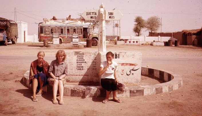 Western tourists wait at a bus stand in Sibi, Balochistan (1975).