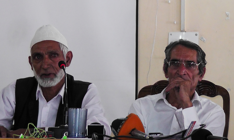 Prominent human rights defender Advocate Parvez Imroz and one of the Kunan Poshpora villagers at the news conference. — Photos by author.