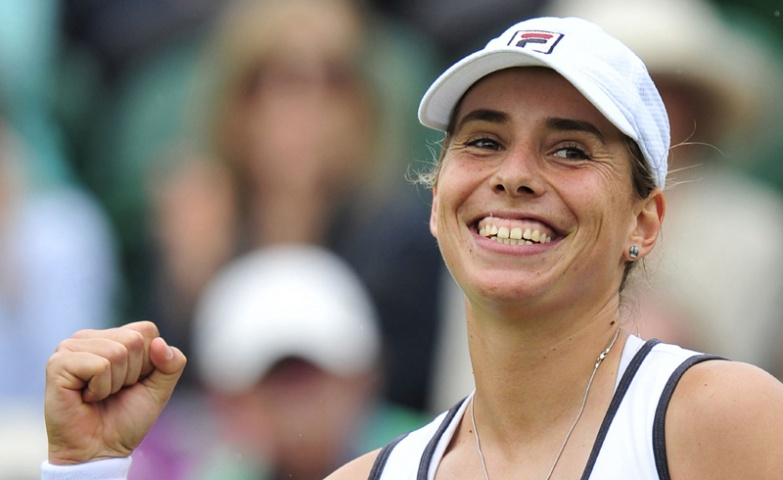 New Zealand's Marina Erakovic celebrates beating China's Peng Shuai during their second round women's singles match on day four of the 2013 Wimbledon Tennis Championships.