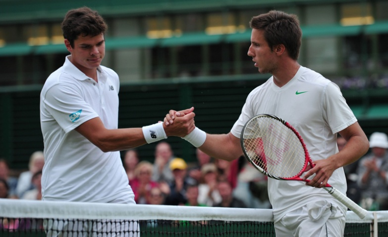 Netherlands' Igor Sijsling (R) shakes hands with Canada's Milos Raonic after Sijsling won their second round men's singles match on day four of the 2013 Wimbledon  Tennis Championships.