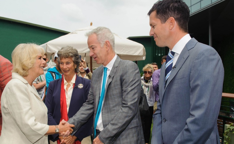 Britain's Camilla, the Duchess of Cornwall (L) meets former tennis players Virginia Wade (2-L), John McEnroe (2-R) and Tim Henman (R) during a visit to the Wimbledon Tennis Championships in London on June 27, 2013.