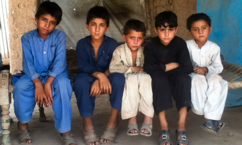(L to R) 10 year old Abdul Wahid, 11 year old Shakirullah, six year old Rohullah, eight year old Saqeem Khan, and five year old Hamad Khan sitting inside a tent.  — Photos provided by author.