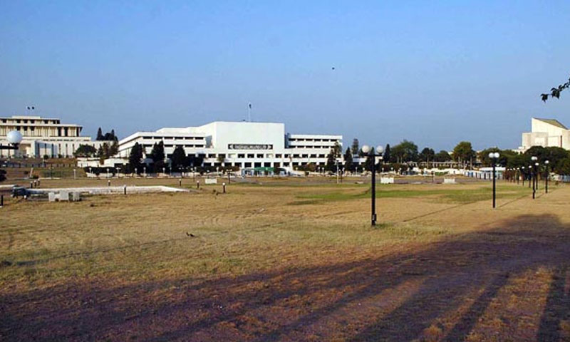 A view of the National Assembly building from a distance. Journalists staged a walkout from the NA's press gallery in protest of the sacking of nine reporters by the BBC Pakistan earlier this year.—File Photo