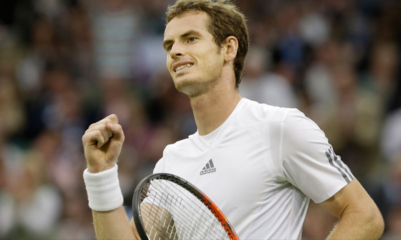 Andy Murray of Britain reacts after defeating Tommy Robredo of Spain during their Men