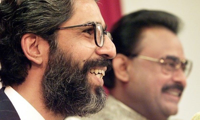 File photo shows Dr Imran Farooq, a founding member of the MQM, with MQM founder Altaf Hussain picture in the background.—AFP/File Photo