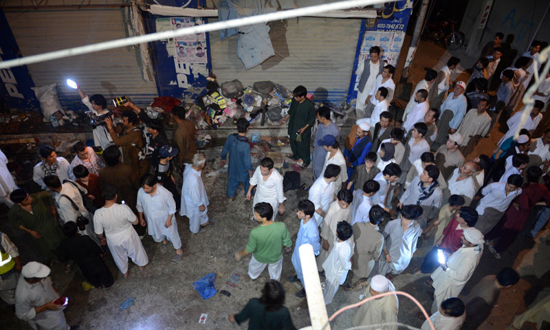 Rescuers and residents gather at the suicide attack site in Quetta on June 30, 2013.—Photo by AFP