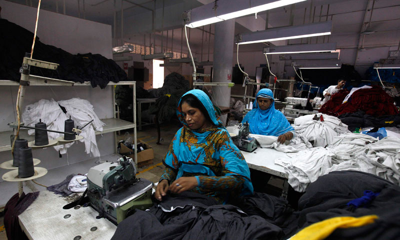 Women workers sew fabrics at a garment factory in Karachi June 24, 2013. Picture taken June 24, 2013. — Photo by Reuters
