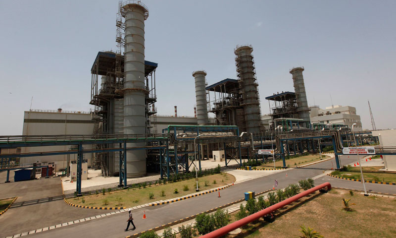 A worker walks at the Bin Qasim Power Station (BQPS-II), some 35 kilometers (22 miles) from east of Karachi city June 20, 2013. — Photo by Reuters