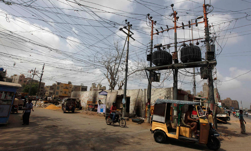 A general view is seen of a street with messy cables from a Pole Mounted Transformers (PMT) at a low income neighborhood in Karachi June 27, 2013. — Photo by Reuters