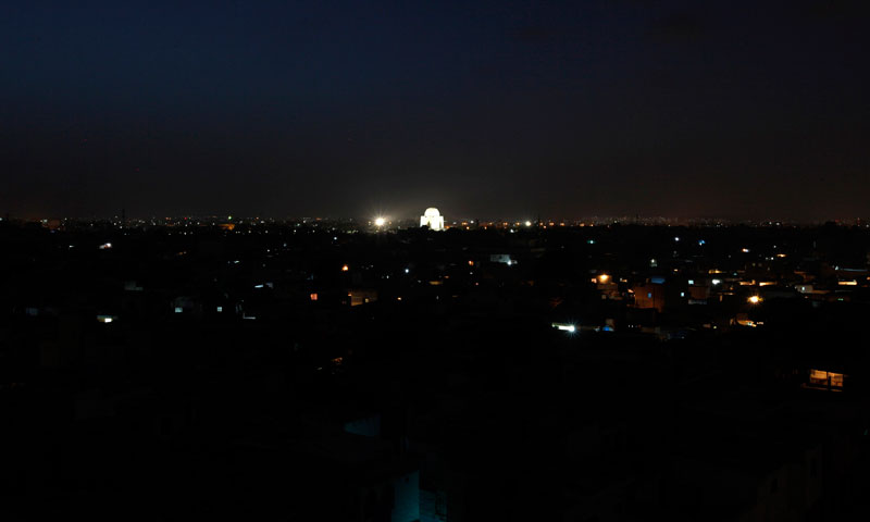 A view is seen of the mausoleum of Mohammad Ali Jinnah illuminated during partial power outages in Karachi June 22, 2013. — Photo by Reuters