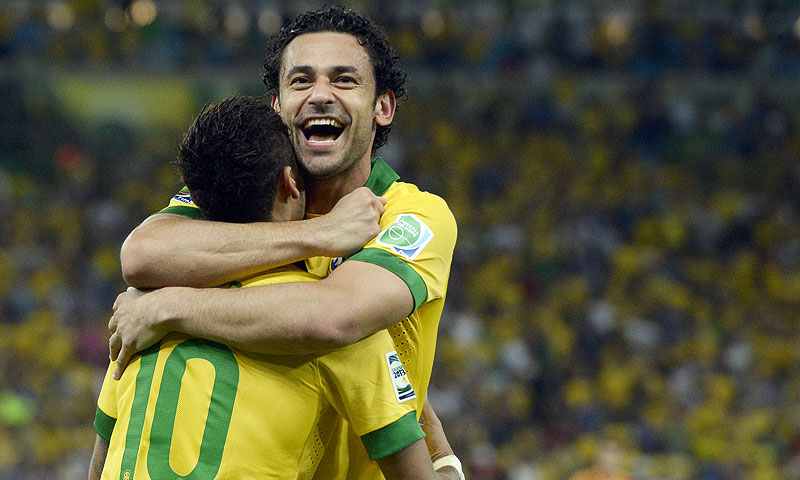 Brazil's forward Fred (R) celebrates with Neymar scoring against Spain. -Photo by AFP