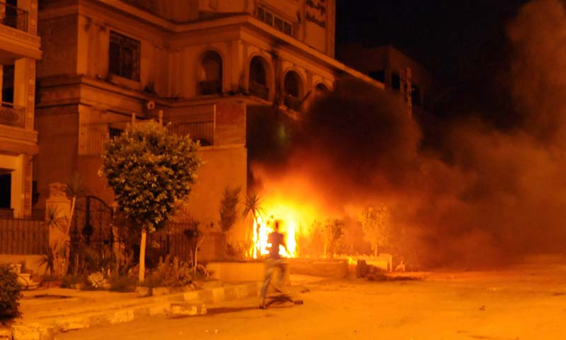 Egyptians opposed to President Mohamed Morsi set fire to the Muslim Brotherhood headquarters in Almoqatam district during clashes in Cairo on June 30, 2013. — Photo AFP