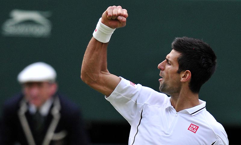 Serbia's Novak Djokovic celebrates winning a point in the third set against Germany's Tommy Haas during their fourth round men's singles match on day seven of the 2013 Wimbledon Championships tennis tournament at the All England Club in Wimbledon, southwest London, on July 1, 2013. — Photo by AFP