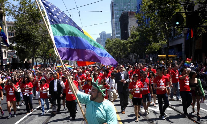 Nikolas Lemos leads Mayor Ed Lee's contingent during 43rd annual San Francisco Lesbian, Gay, Bisexual, Transgender (LGBT) Pride Celebration & Parade June 30, 2013, in San Francisco, California. The annual S.F. Pride Parade occurred just days after same-sex marriages were reinstated in California following the recent Supreme Court rulings.  — Photo by AFP