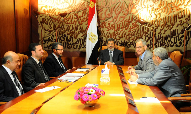 Egyptian President Mohamed Morsi (C) meets with his prime minister Hisham Kandil (3rd L) and other ministers in Cairo on July 1, 2013. — Photo by AFP