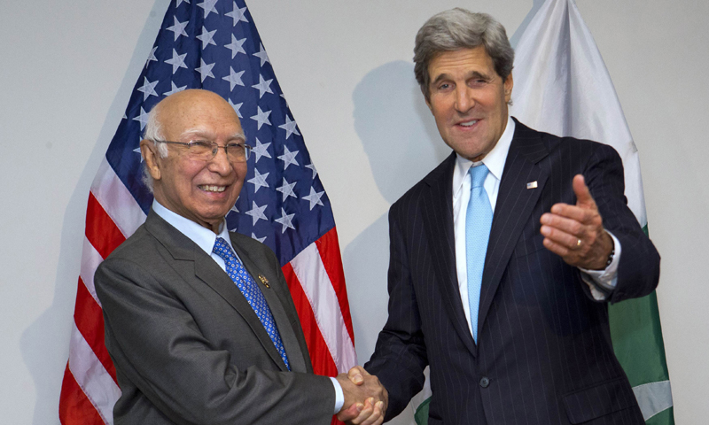 US Secretary of State John Kerry (R) shakes hands with Sartaj Aziz, Pakistan's advisor for national security and foreign affairs, during ASEAN meetings in Bandar Seri Begawan, Brunei on July 2, 2013. — Photo by AFP