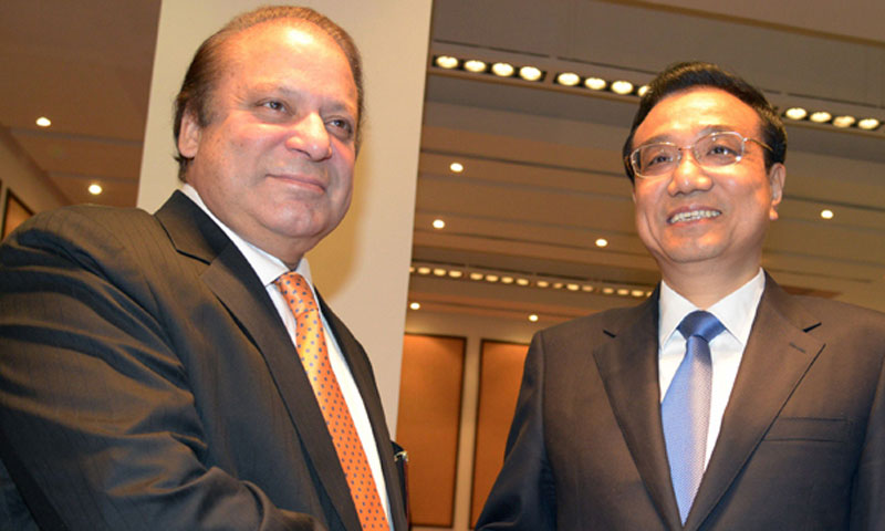 Prime Minister Nawaz Sharif with Premiere Li Keqiang during his visit to Pakistan. — File photo