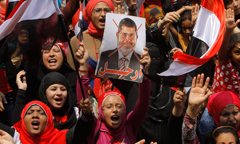 Opponents of Egypt's Islamist President Mohammed Morsi shout slogans during a protest in Tahrir Square in Cairo, Egypt, Wednesday, July 3, 2013. —AP Photo