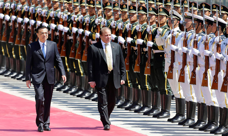 Pakistan's Prime Minister Nawaz Sharif inspects the guard of honour with Chinese Premier Li Keqiang (L) during a welcome ceremony outside the Great Hall of the People in Beijing, July 5, 2013. — Photo by Reuters