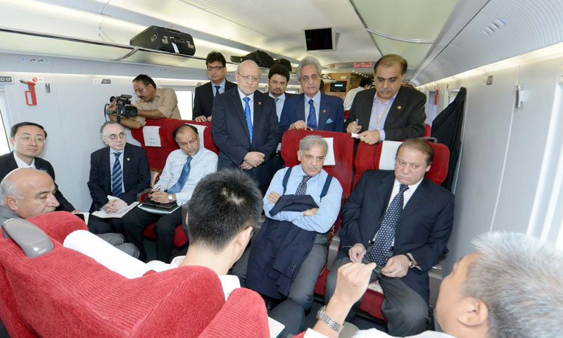 High speed train management Deputy General, Zhao briefs Prime Minister Nawaz Sharif during travelling in bullet train in Shanghai on Saturday.—Online Photo