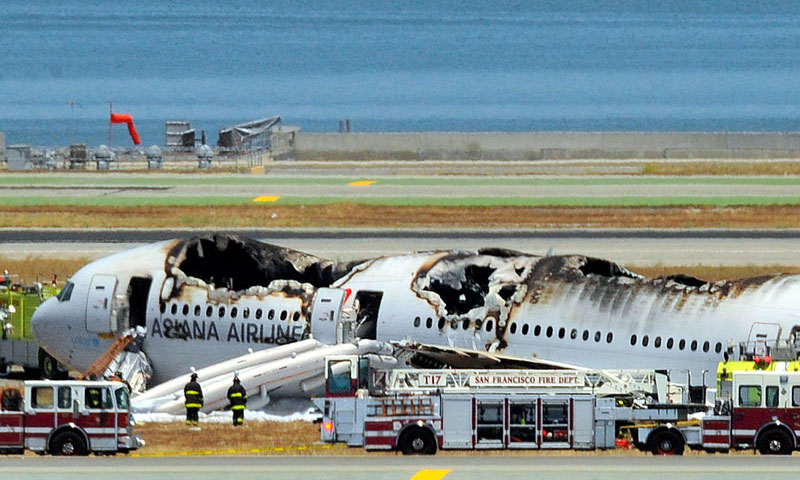 An Asiana Airlines Boeing 777 is seen on the runway at San Francisco International Airport after crash landing on July 6, 2013.—Photo by AFP
