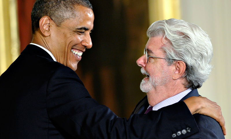 President Barack Obama hugs director George Lucas before presenting him with the 2012 National Medal of Arts, Wednesday, July 10, 2013, during a ceremony in the East Room of White House in Washington. — AP Photo