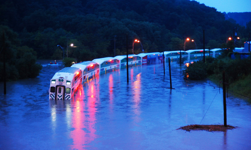 A GO Train is stranded on flooded tracks in Toronto. -AP Photo/The Canadian Press, Winston Neutel
