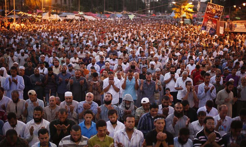 Supporters of the deposed Egyptian President Mohamed Mursi pray during a protest in Cairo July 12, 2013. Islamist supporters of Mursi, protested in Cairo on Friday after a week of violence in which more than 90 people were killed in a bitterly divided nation. — Photo by Reuters