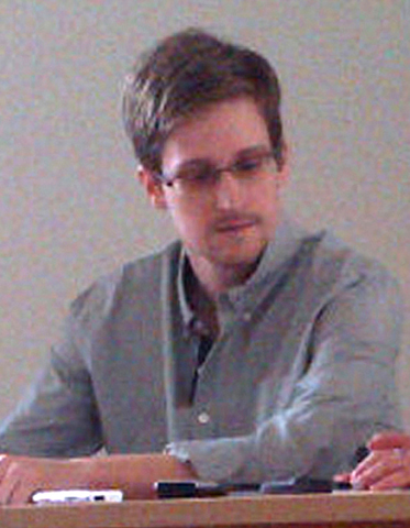 Picture released by Human Rights Watch shows US National Security Agency (NSA) fugitive leaker Edward Snowden during a meeting with rights activists at Moscow's Sheremetyevo airport, on July 12, 2013. Fugitive US intelligence leaker Edward Snowden on Friday told a group of activists that he wanted to claim asylum in Russia because he is unable to fly on anywhere else. — AFP/ Human Rights Watch Photo
