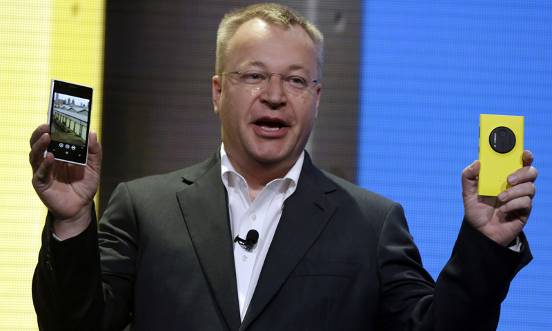 Nokia CEO Stephen Elop shows his company's Nokia Lumia 1020, in New York,  Thursday, July 11, 2013. — AP Photo