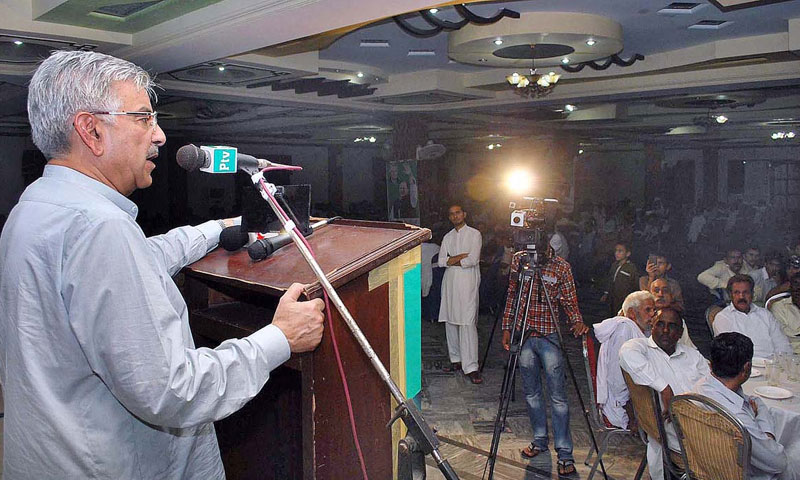 Federal Minister for Water and Power Khawaja Mohammad Asif addressing PML-N workers.—Online Photo