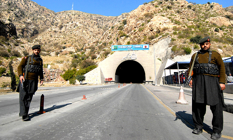 Paramilitary soldiers stand in front of a Japanese-built tunnel linking a key road to lawless areas of KP in Darra Adam Khel. -File photo by AFP