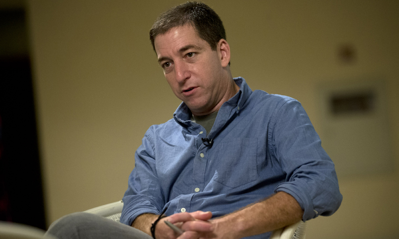 "Journalist Glenn Greenwald speaks during an interview with the Associated Press in Rio de Janeiro, Brazil, Sunday, July 14, 2013.  Greenwald, The Guardian journalist who first reported Edward Snowden's disclosures of US surveillance programs says the former National Security Agency analyst has ""very specific blueprints of how the NSA do what they do."" — AP Photo"