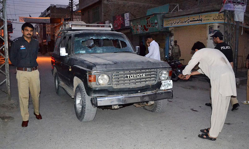 Photo shows the vehicle of the four victims of the gun attack in Quetta on July 15, 2013.—Photo by Online