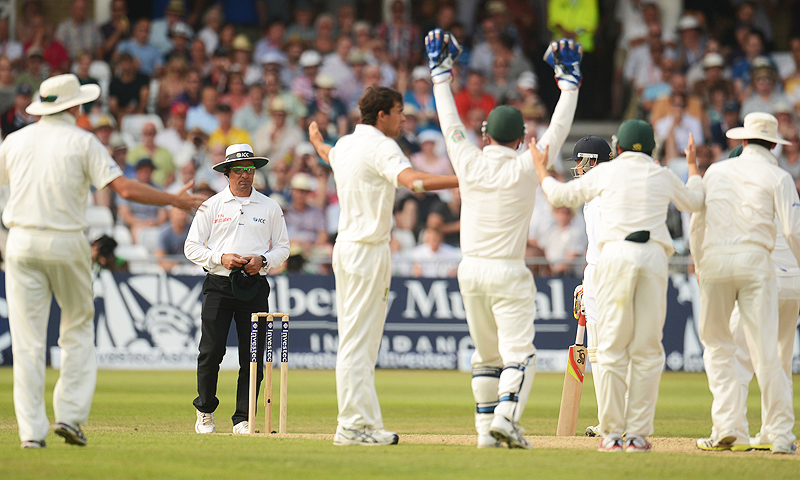 Australia's players appeal in vain for the dismissal of England's Stuart Broad to umpire Aleem Dar. -Photo by Reuters