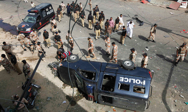 This picture shows paramilitary soldiers and police officers at the site of a bomb attack. The target was SHC judge Justice Maqbool Baqar.—File Photo.